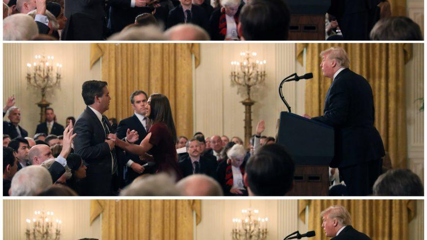 Seorang anggota staf Gedung Putih berusaha meraih mikrofon yang dipegang Jim Acosta dari CNN saat dia bertanya kepada Presiden AS Donald Trump. (Foto: Reuters/Al Jazeera)