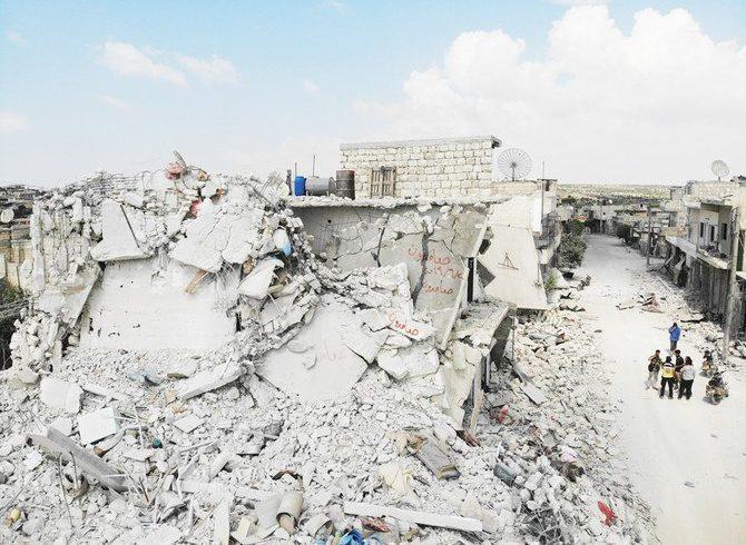 Bangunan yang rusak dan hancur di kota Ihsim, di wilayah Idlib Suriah, pada hari Jumat. (Foto:AFP/Arab News)