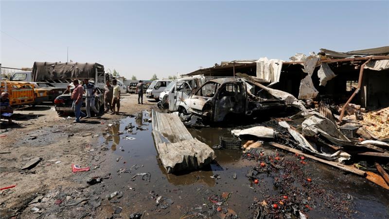 Bom mobil di pasar Rashidiyah, di bagian utara Ibukota Irak, Baghdad, Selasa (12/7).